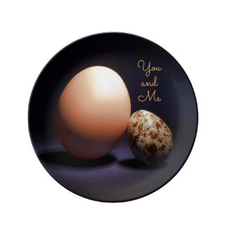 Сhicken and quail eggs in love. Text «You and Me». Plate
