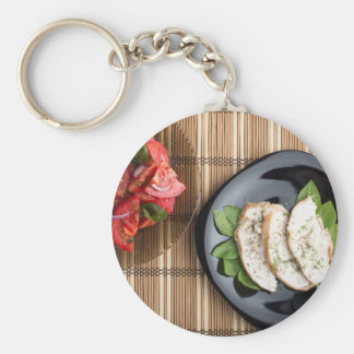 Сhicken meat decorated with basil and tomato salad basic round button keychain