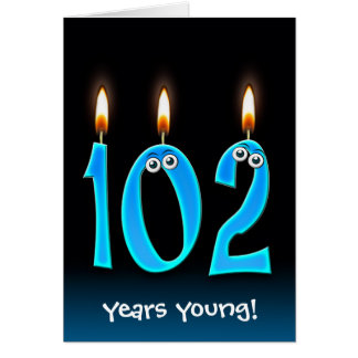 102nd birthday candles on black card