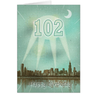 102nd Birthday card with a city and spotlights