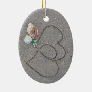 2 Hearts  in the sand with shells Ceramic Oval Ornament