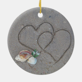 2 Hearts  in the sand with shells Round Ceramic Ornament