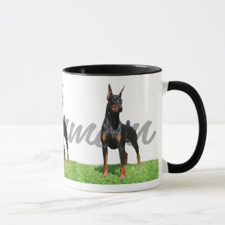 3 black Doberman Pinschers w/ breed name graphic Mug