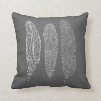 3 Feathers on Grey Pillow