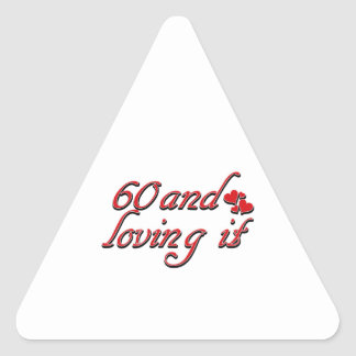 60 and loving it triangle sticker