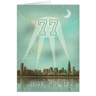 77th Birthday card with a city and spotlights