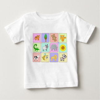 A baby t-shirt with a cute cartoon on.