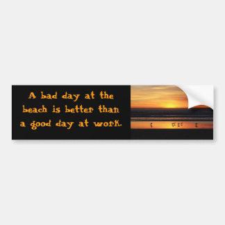 A bad day at the beach bumper sticker