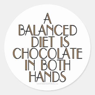 A balanced diet is chocolate in both hands round sticker