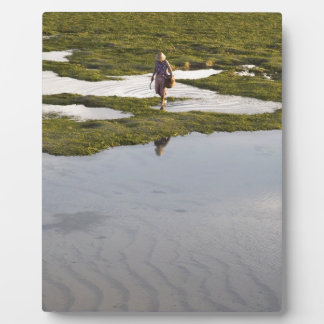 A beach scene of a villager taken in Bali island Plaque