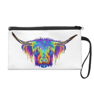 A beautiful colourful cow. wristlet purses