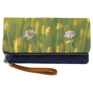 A bee on the Spring wild flowers Clutch