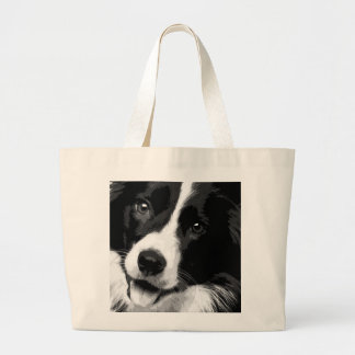 A black and white Border collie Large Tote Bag