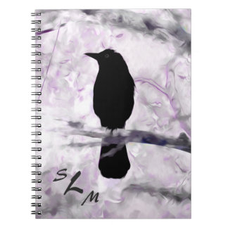 A Black Bird on a Branch with Purple, Pink and Gra Note Books
