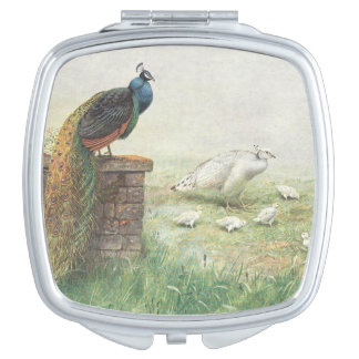 A Blue Peacock and white peahen with chicks Makeup Mirror