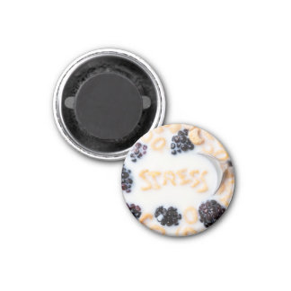 A bowl of alphabet cereal pieces floating in milk 1 inch round magnet