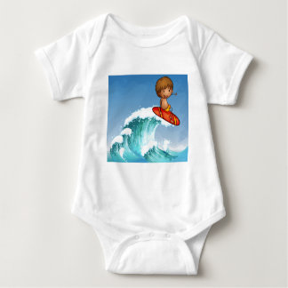 A boy surfing in the waves baby bodysuit