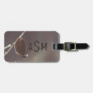 A Brown Leaf on a Gray Background in Grunge Style Luggage Tag