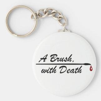 A Brush, with Death logo keyring