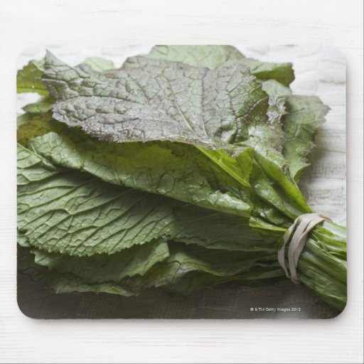 A bunch of fresh mustard greens, from a farmer's mouse pad