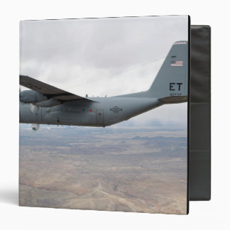 A C-130 Hercules soars through the sky 3 Ring Binders