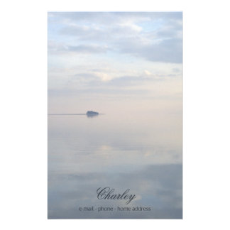 A calm sea, reflections and the island stationery