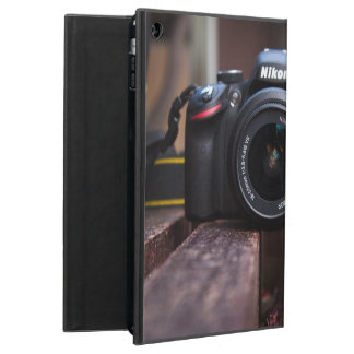 A camera on a table iPad air case
