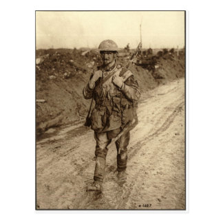 A Canadian Tommy soldier covered in mud returning Postcard