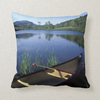 A canoe rests on the shore of Little Long Pond Throw Pillow