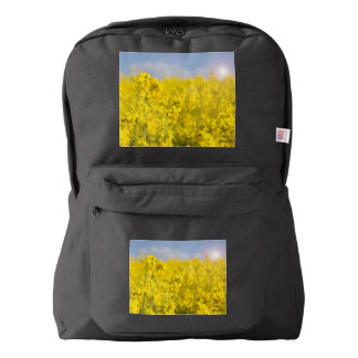 A canola field in spring backpack