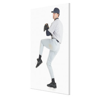 a caucasian man wearing a white baseball uniform stretched canvas prints