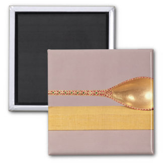 A ceremonial spoon fridge magnet