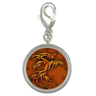 A charm raised, dragon design, copper background