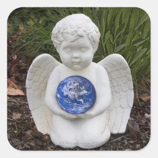 A cherub in the garden cradles the earth square sticker