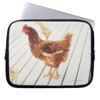 A Chicken and Two Chicks On a Wooden Floor, Laptop Sleeve