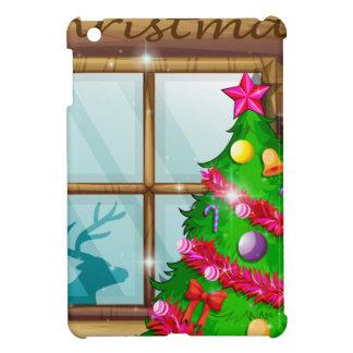 A christmas tree near the window iPad mini case