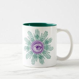 A circle of hands and an Eye Two-Tone Coffee Mug
