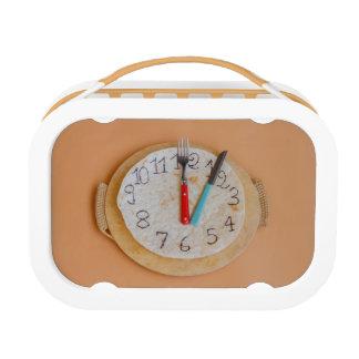 A CLOCK MADE OF PIADINA ON ORANGE YUBO LUNCH BOX