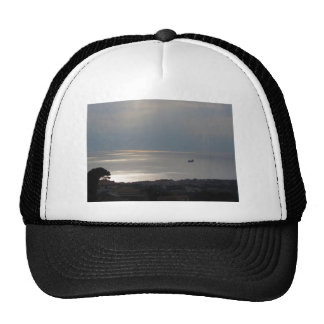 A cloudy sea and a setting sun hats