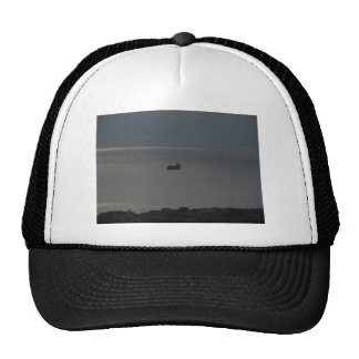 A cloudy sea and a setting sun trucker hat