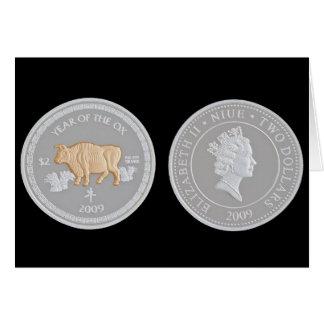 A commemorative silver coin card