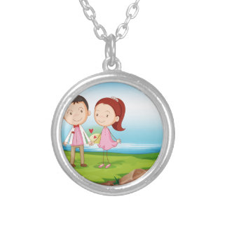 A couple at the riverbank near the rocks silver plated necklace