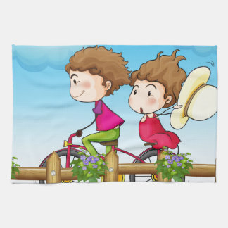 A couple riding a bicycle towel