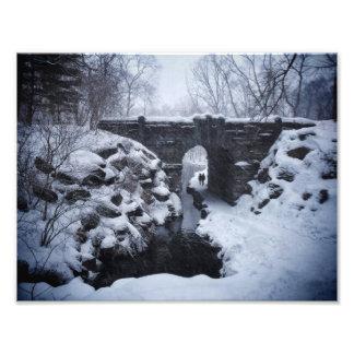A Couple Walking Under a Snowy Glen Span Arch Photo Art