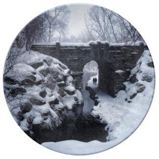 A Couple Walking Under a Snowy Glen Span Arch Porcelain Plate
