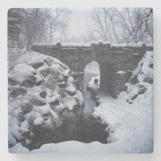 A Couple Walking Under a Snowy Glen Span Arch Stone Coaster