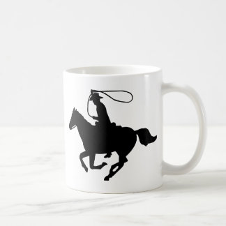 A cowboy riding with a lasso. coffee mug