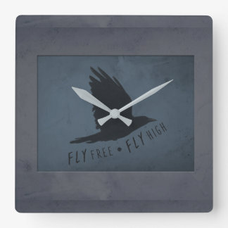 A Crow in Flight on Grungy Blue & Gray Background Square Wall Clock