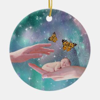 A cute baby boy in hand fantasy round ceramic ornament
