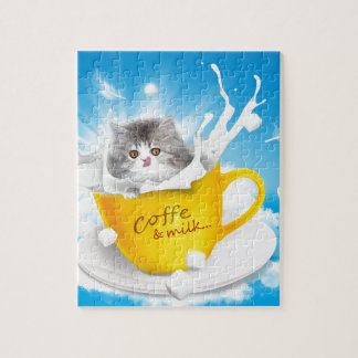 A cute Kitten Sitting in a cup of  milk Puzzle
